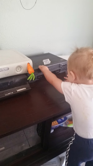 Getting into the Easter spirit by sticking a pretend carrot in the XBox.